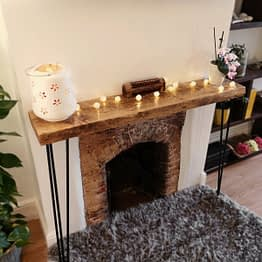 a rustic console unit above fireplace