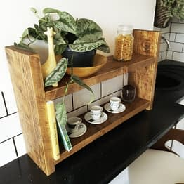 A rustic countertop unit with a yellow bowl on
