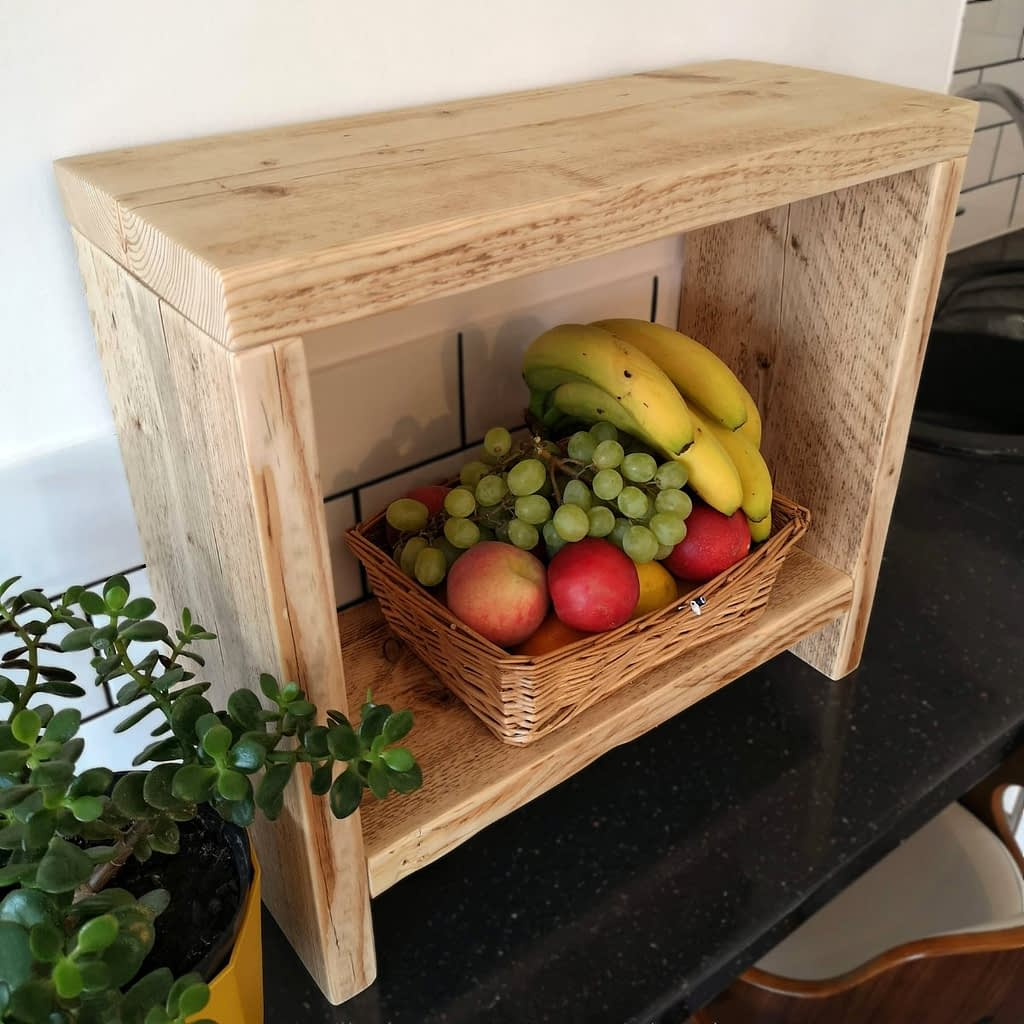 A reclaimed timber counter-top side table with fruit on