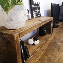 A wooden rustic desktop organiser shelf unit