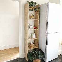 tall slim rustic bookcase handmade with shelves and kitchen utensils
