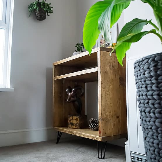 A rustic reclaimed wood record player vinyl unit front side angle