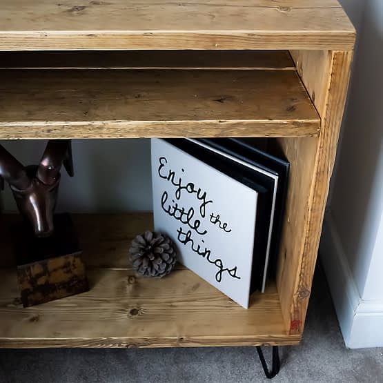 A rustic reclaimed wood record player vinyl unit front with hairpin legs