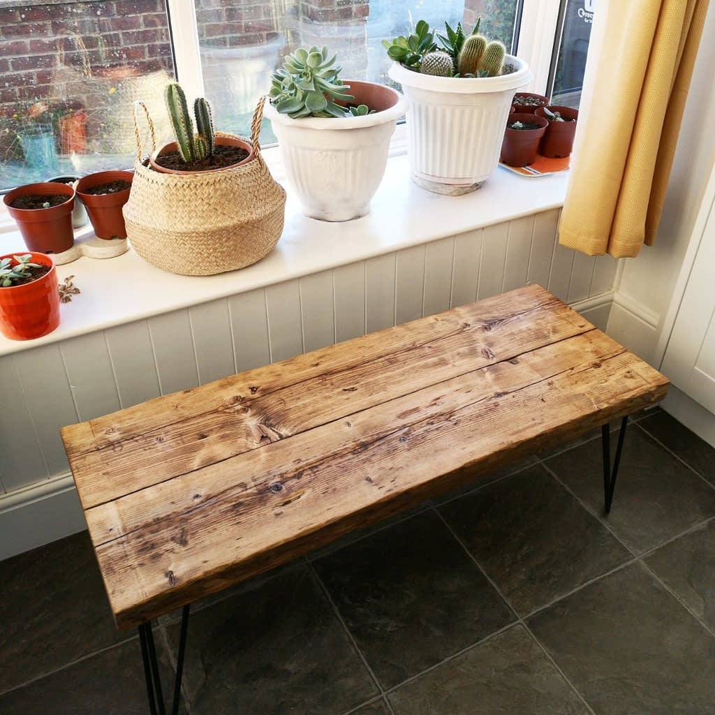 A thick medium oak rustic coffee table with hairpin legs