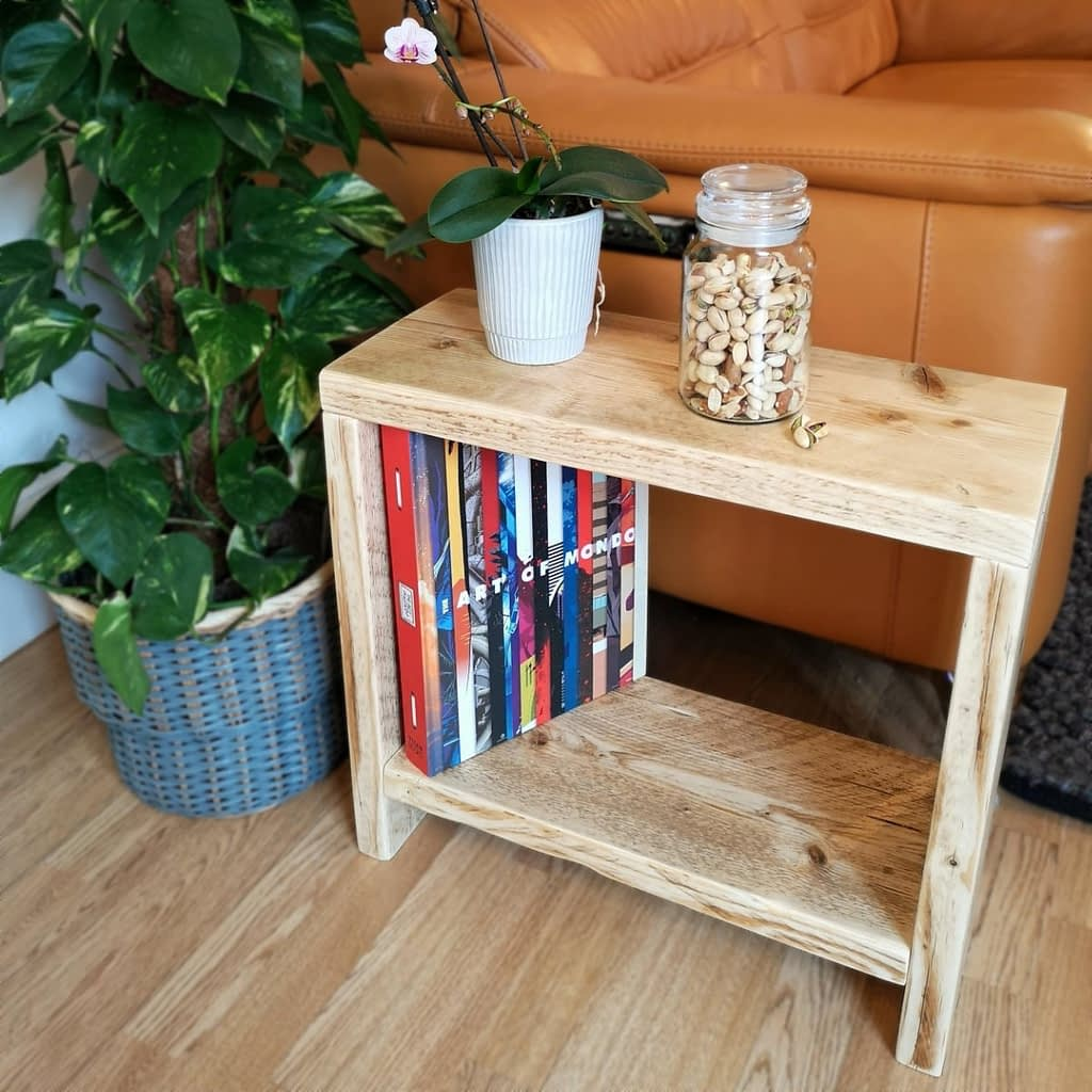 A reclaimed timber side table with an orchid on
