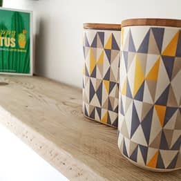 two tins on a rustic wood shelf